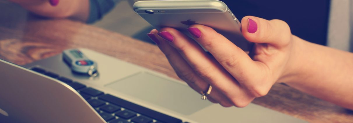 A woman on her phone enquires about mindset coaching for entrepreneurs.